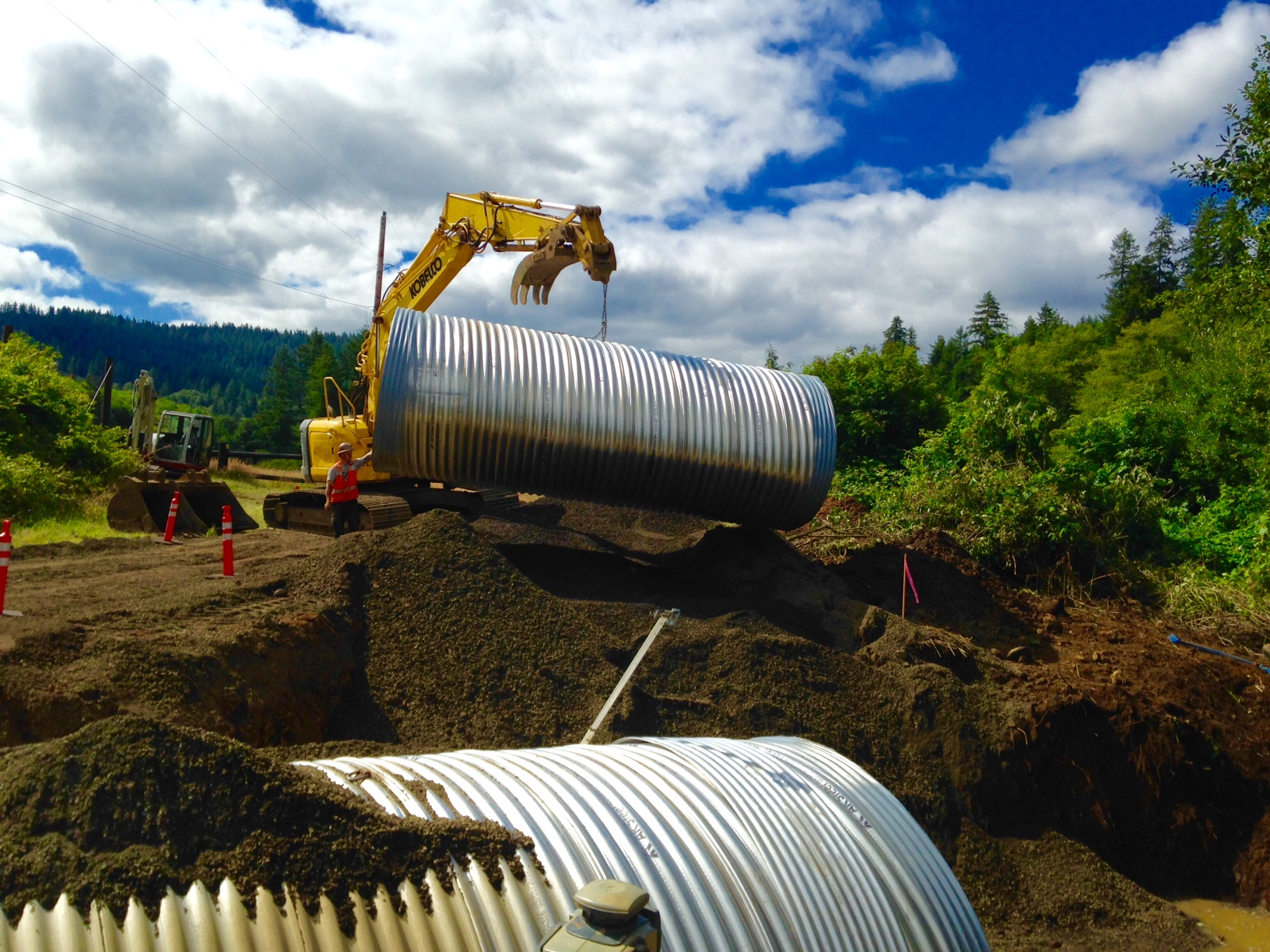 Moon 1208 Construction-Moving downstream section of culvert into place
